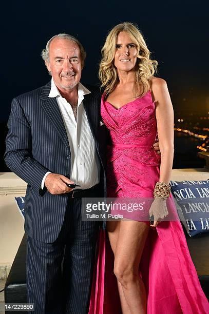 Michele Lo Foco and Tiziana Rocca attend at the Lancia Cafe during the 58th Taormina Film Fest on June 27 2012 in Taormina Italy