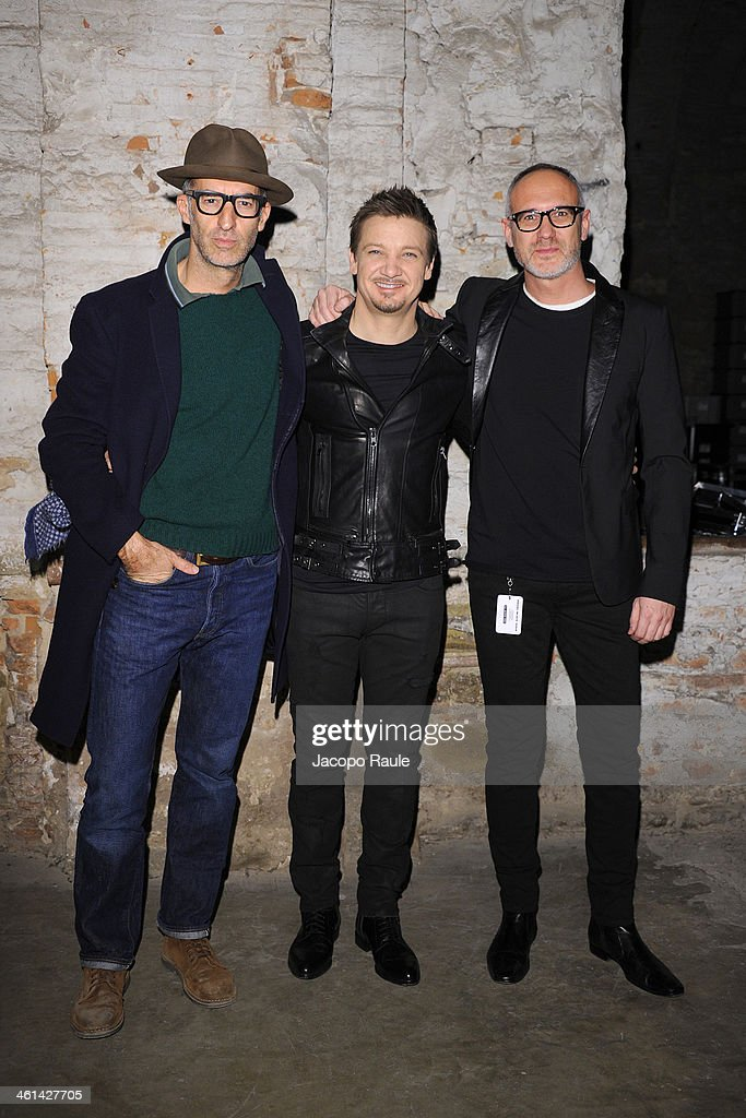 Michele Lupi, Jeremy Renner and Giacomo Nicolodi attend Diesel Black Gold fashion show during Pitti Immagine Uomo 85 on January 8, 2014 in Florence, Italy.