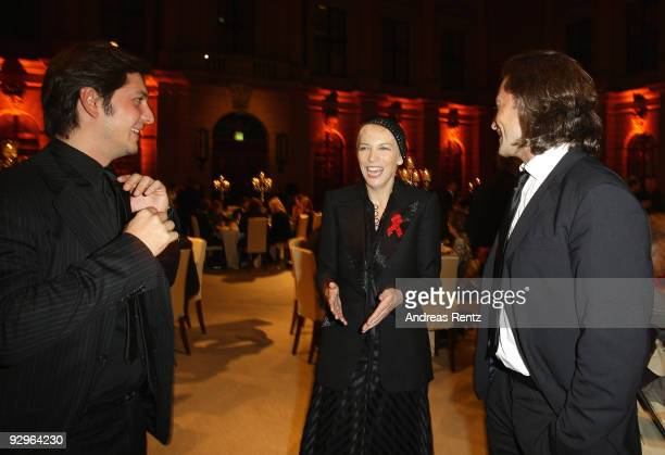 Michele Malenotti and Manuele Malenotti vice presidents of Belstaff and musician Annie Lennox attend the gala dinner BELSTAFF FOR PEACE to the 10th...