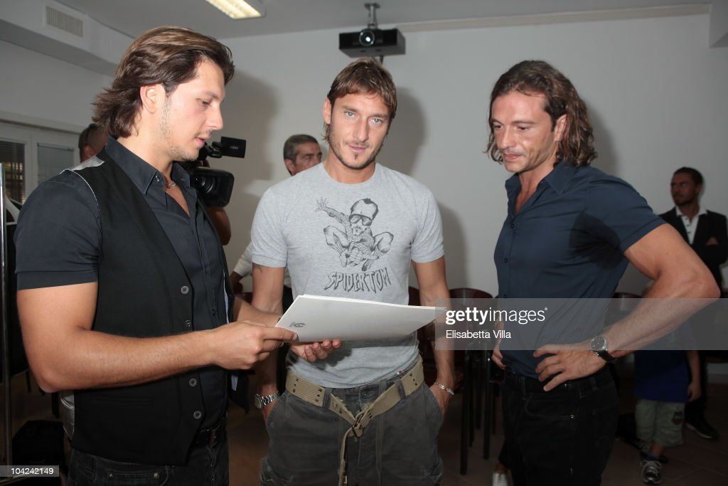 Michele Malenotti, Francesco Totti and Manuele Malenotti attend the Belstaff Official Meeting with AS Roma football player at the AS Roma headquarters Trigoria on September 18, 2010 in Rome, Italy.