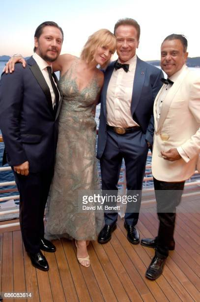 Michele Malenotti Uma Thurman Arnold Schwarzenegger and Pascal Borno attend the Vanity Fair and HBO Dinner celebrating the Cannes Film Festival at...