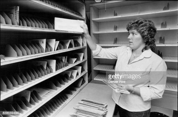 Michele Mankowski a temporary 'casual' carrier with the USPS practices sorting letters in preparation for her test at the end of her training to...