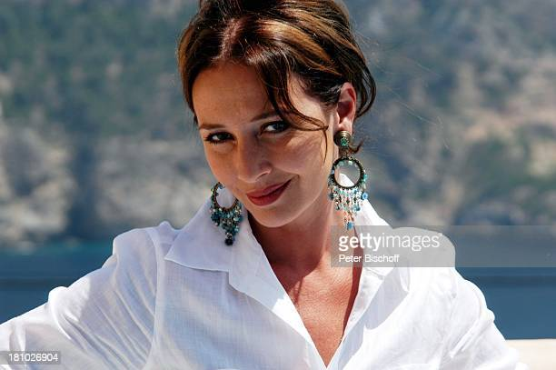 07 April 1963 Sternzeichen Widder Porte 'de Andratx/Mallorca/Spanien Schauspielerin Promis Prominente Prominenter Portrait Ohrringe Urlaub