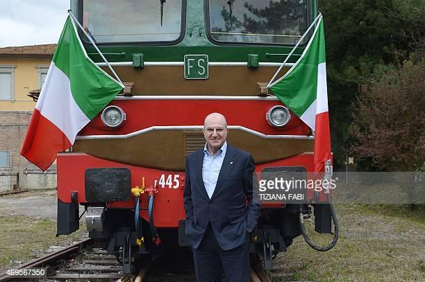Michele Mario Elia CEO of Ferrovie dello Stato Italiane poses on April 11 2015 at the Torrenieri Montalcino railway station during a presentation of...