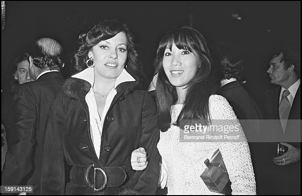 Michele Mercier and Mei Chen Chalais attend a party at Paradis Latin cabaret in Paris in 1977