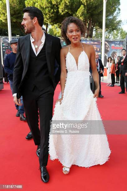 Michele Morrone and Virginia Diop attend the Bar Giuseppe red carpet during the 14th Rome Film Festival on October 18 2019 in Rome Italy