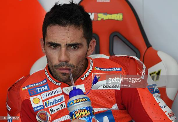 Michele Pirro of Ducati Teamlooks on in his pit during MotoGP of San Marino Free Practice at Misano World Circuit on September 9 2016 in Misano...