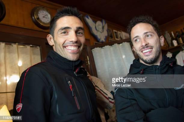 "Michele Pirro of Italy and Ducati Team and Andrea Dovizioso of Italy and Ducati Team smile in restaurant ""Passo della Futa"" during the MotoGp of..."