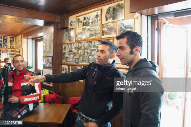 Michele Pirro of Italy and Ducati Team and Danilo Petrucci of Italy and Ducati Team speak with Ducati fans in restaurant Passo della Futa during the...