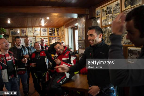 Michele Pirro of Italy and Ducati Team speaks with Ducati fans in restaurant Passo della Futa during the MotoGp of Italy Filming Day at Mugello...
