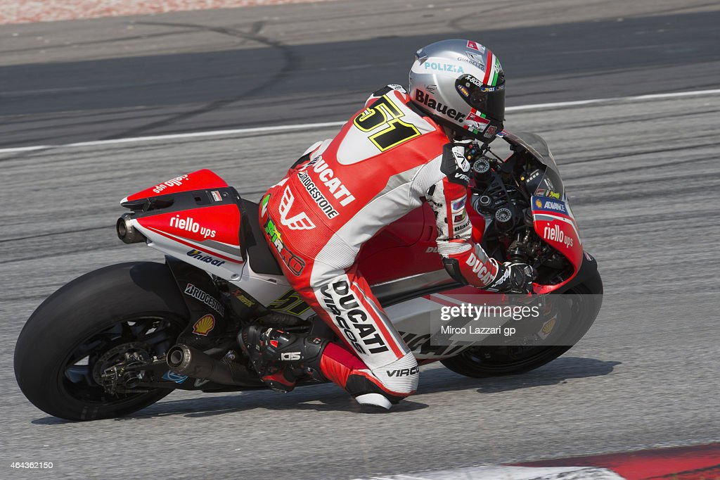 Michele Pirro of Italy and Ducati Test Team rounds the bend during day three of the Sepang MotoGP Tests at Sepang Circuit on February 25, 2015 in Kuala Lumpur, Malaysia.