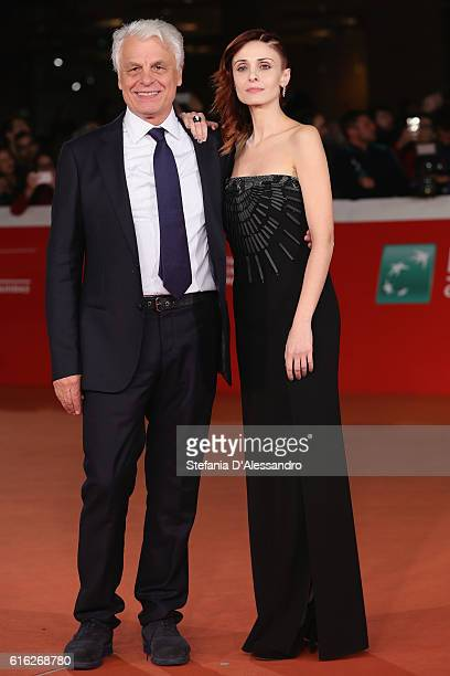 Michele Placido and Federica Vincenti walk a red carpet for '7 Minuti' during the 11th Rome Film Festival at Auditorium Parco Della Musica on October...