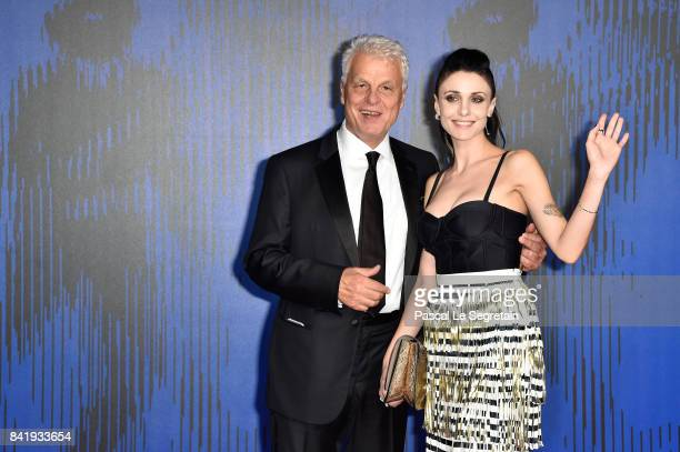 Michele Placido and Federica Vincenti walk the red carpet ahead of the 'Suburra. La Serie' screening during the 74th Venice Film Festival at Sala...