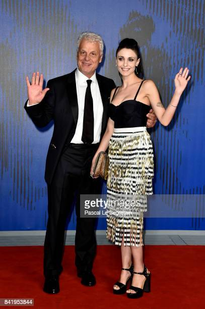 Michele Placido and Federica Vincenti walk the red carpet ahead of the 'Suburra La Serie' screening during the 74th Venice Film Festival at Sala...