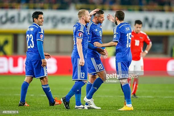 Michele Polverino, Martin Buechel, Mario Frick and Seyhan Yildiz of Liechtenstein celebrate during the UEFA EURO 2016 Qualifier between Austria and...