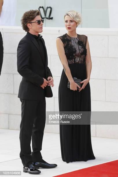 Michele Riondino and Eva Nestori walk the red carpet ahead of the opening ceremony and the 'First Man' screening during the 75th Venice Film Festival...