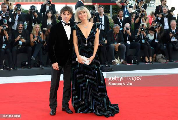 Michele Riondino and Eva Nestori walk the red carpet ahead of the Award Ceremony during the 75th Venice Film Festival at Sala Grande on September 8...