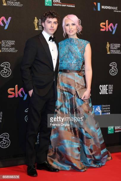 Michele Riondino and Eva Nestori walk the red carpet of the 61. David Di Donatello on March 27, 2017 in Rome, Italy.