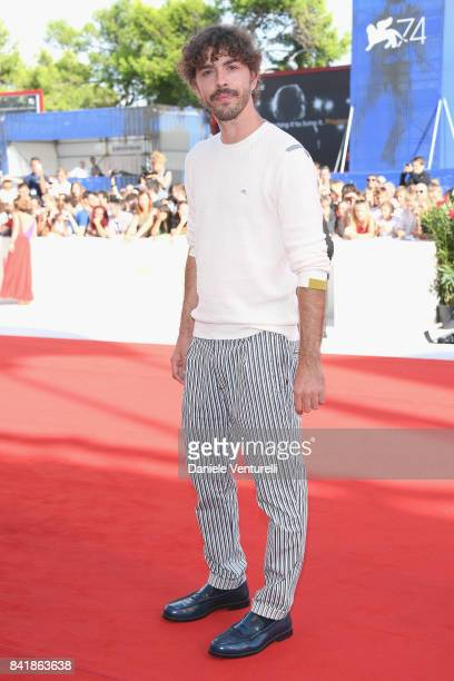 Michele Riondino from the movie Diva walks the red carpet ahead of the 'Foxtrot' screening during the 74th Venice Film Festival at Sala Grande on...