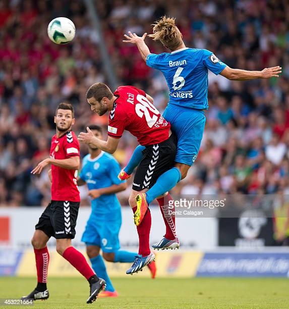Michele Rizzi of Grossaspach challenges Sandrino Braun of Stuttgarter Kickers for a header during the third league match between SG Sonnenhof...
