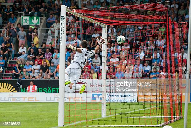 Michele Rizzi of Grossaspach scores the first goal for his team against goalkeeper Korbinian Mueller of Stuttgarter Kickers during the third league...