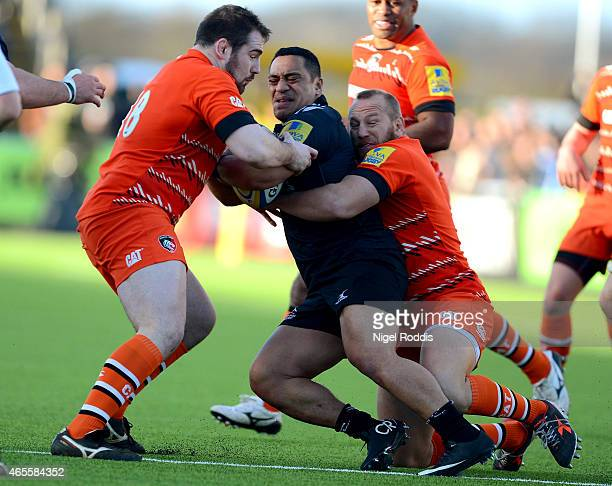 Michele Rizzo and Fraser Balmain of Leicester Tigers challenge Sinoti Sinoti of Newcastle Falcons during the Aviva Premiership match between...