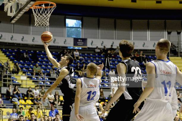 Michele Rubbini and Matteo Berti of Unipol competes with Federico Poser and Enrico Vanin of Universo during the Italian Basketball Under 20...