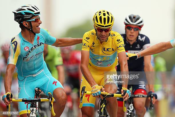Michele Scarponi of Italy and the Astana Pro Team congratulates team mate and Tour de France winner Vincenzo Niabli of Italy as he crosses the...