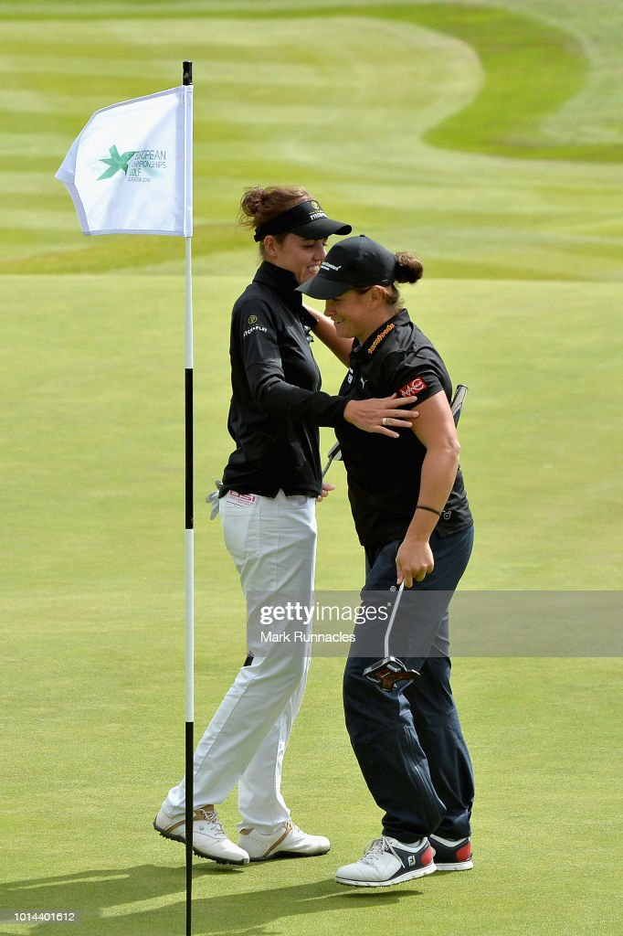 Michele Thomson and Meghan Maclaren of Great Britain hug after putting on hole eighteen during match 6 of Group C during day three of the European Golf Team Championships at Gleneagles on August 10, 2018 in Auchterarder, Scotland. This event forms part of the first multi-sport European Championships.