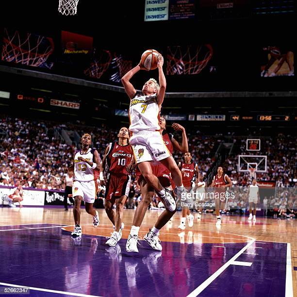Michele Timms of the Phoenix Mercury shoots a jumpshot against the Houston Comets during a WNBA game at the America West Arena on July 22 1997 in...