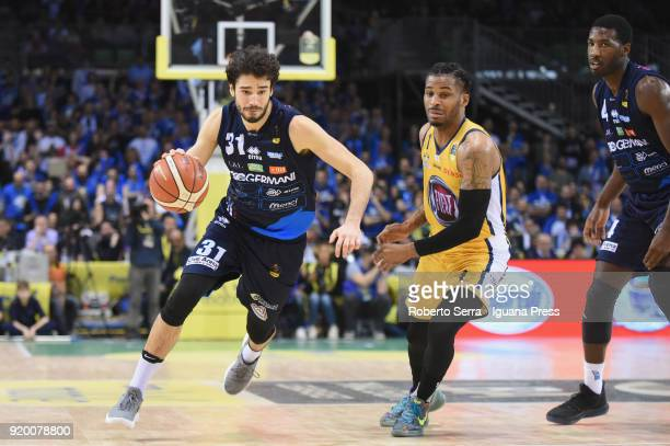 Michele Vitali and Dario Hunt of Germani competes with Vander Blue of Fiat during the LBA LegabLasket match ifinal of Coppa Italia between Auxilium...