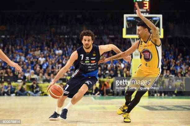 Michele Vitali of Germani competes with Diante Maurice Garrett of Fiat during the LBA LegabLasket match ifinal of Coppa Italia between Auxilium Fiat...