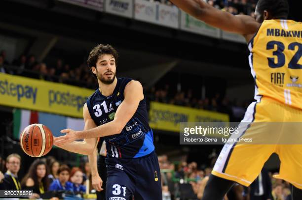 Michele Vitali of Germani competes with Trevor Mbakwe of Fiat during the LBA LegabLasket match ifinal of Coppa Italia between Auxilium Fiat Torino...