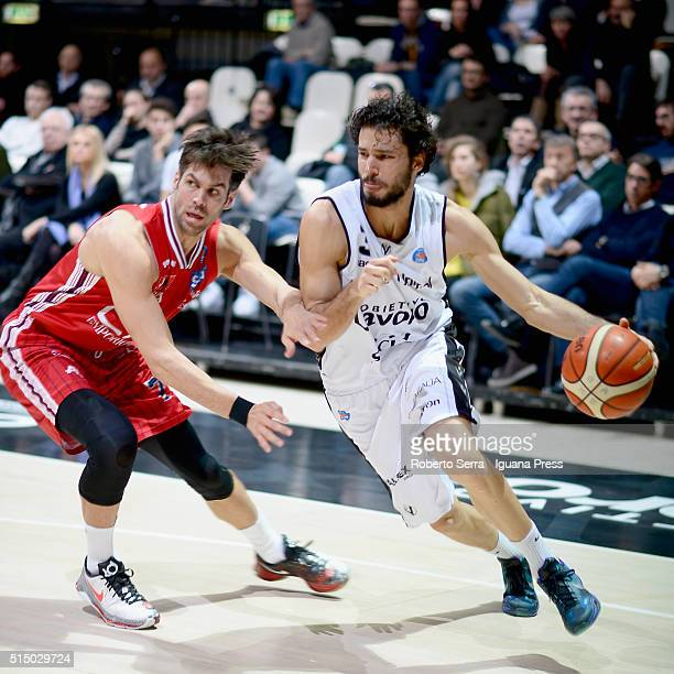 Michele Vitali of Obiettivo Lavoro competes with Bruno Cerella of EA7 during the LegaBasket match between Virtus Obiettivo Lavoro and EA7 Emporio...