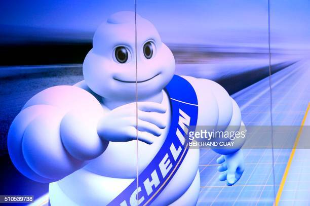 Michelin Man or Bibendum the symbol of the Michelin tire company is pictured during a press conference to present the group's results on February 16...