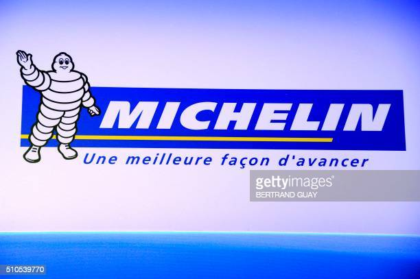 Michelin Man or Bibendum the symbol of the Michelin tire company is pictured during a press conference to present the group's results in Paris on...