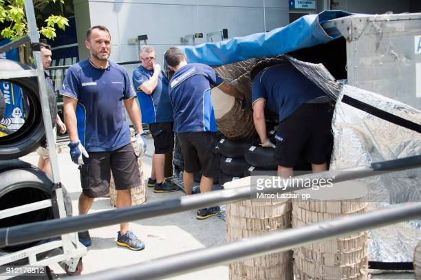 Michelin staff at work in the pit in order to organize the crates for traveling in Thailand during the MotoGP test in Sepang at Sepang Circuit on...