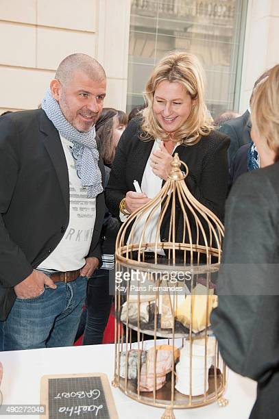 Michelin star chef Philippe Etchebest and Luana Belmondo speak to Cheese makers during the 'Fromage Fashion Week Menu' on September 27 2015 in Paris...