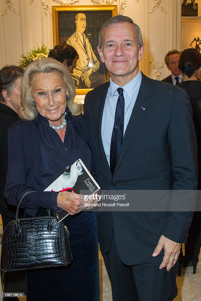 Micheline Maus (L) and Francis Huster attend the signing of Francis Huster's book 'And Dior Created Woman' at Dior Boutique on November 19, 2012 in Paris, France.