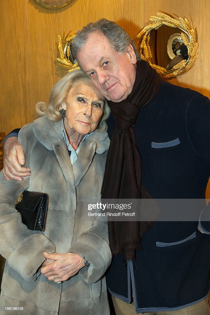 Micheline Mauss (L) and interior decorator Jacques Grange attend the 'Sorcieres' (Witches) exhibition preview at Galerie Pierre Passebon on January 8, 2013 in Paris, France.