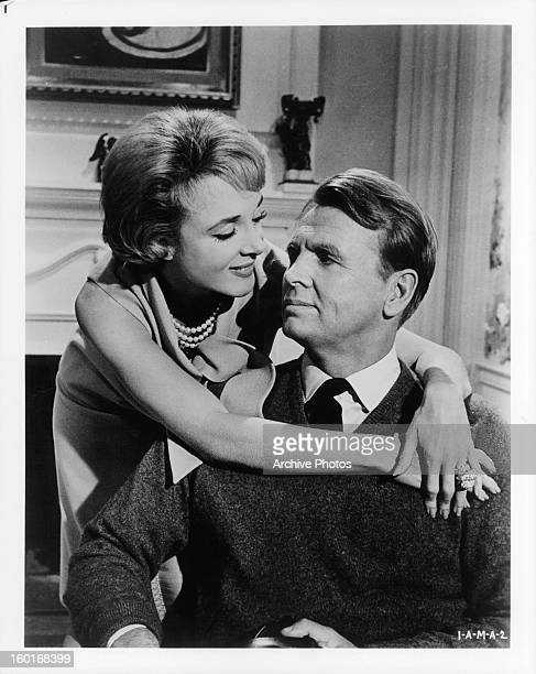 Micheline Presle has her arms around John Lund as they gaze into one an others eyes in a scene from the film 'If A Man Answers' 1962