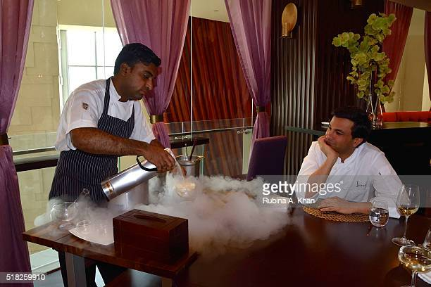 Michelinstarred Indian chef Vikas Khanna watches his Pastry Chef Asrar Ahmed prepare a signature dessert a Table Side Kulfi with liquid nitrogen at...