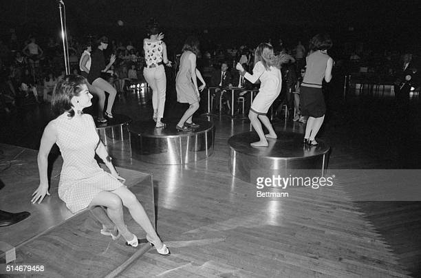 Michell Neville of Vichy France sits on the bandstand watching girls dance at the Cheetah nightclub Approximately five hundred girls turned up at the...