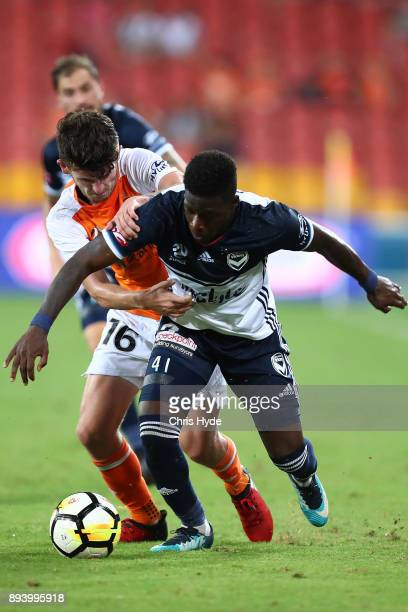 Michell Oxborrow of the Roar and Leroy George of Vivtory compete for the ball during the round 11 ALeague match between the Brisbane Roar and the...