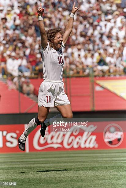 Michelle Akers of Team USA jumps in celebration during the Women''s World Cup game against Team Brazil at the Stanford Stadium on July 4 1999 in Palo...