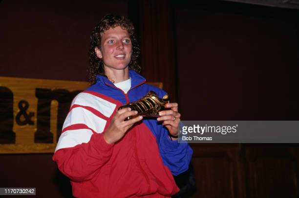 Michelle Akers of the winnning United States team, holds the golden boot trophy after scoring ten goals in the 1991 FIFA Women's World Cup tournament...