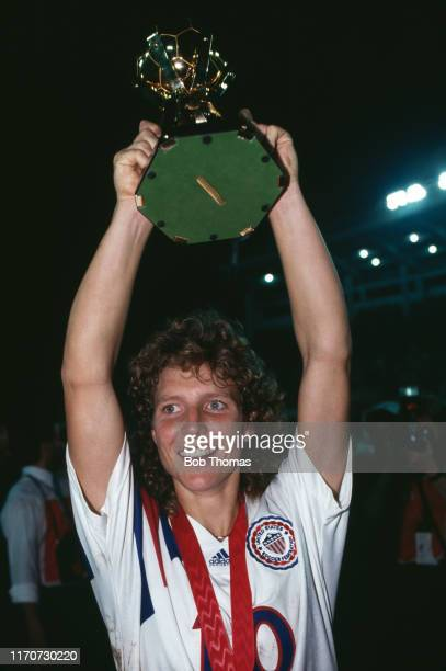 Michelle Akers , scorer of two goals, raises the trophy in the air in celebration after the United States beat Norway 2-1 in the final of the 1991...