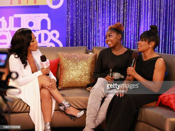 K Michelle Alijah Kai Haggins and Tichina Arnold speak during the Post Show for the 2018 Soul Train Awards presented by BET at the Orleans Arena on...