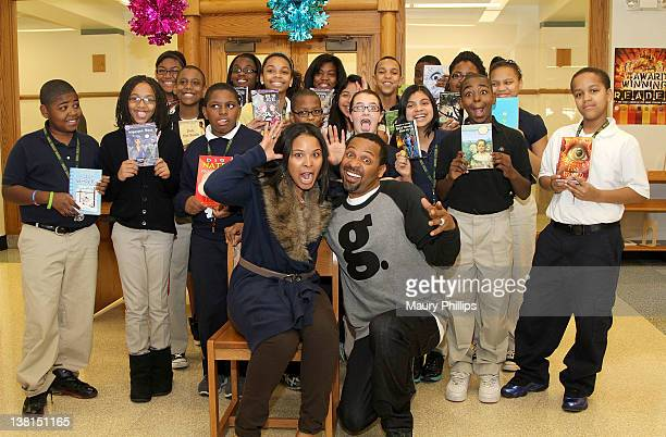 Michelle and Mike Epps pose withe students during the Michael and Mechelle Epps Foundation Media Day at the Crispus Attucks Medical Magnet High...