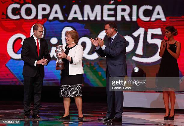Michelle Bachelet President of Chile receives a replica of the official trophy of Copa America from Sergio Jadue President of the Chilean Football...